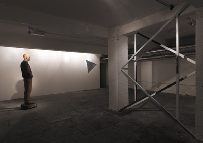 left: Ralf Sander, Goetz, 1999, maple, 185 x 50 x 72 cm; right: Noel Brennan, Samson and the Philistines (12 triangles), 2008, white deal, gaffer tape, tinting gel; photo David Monaghan